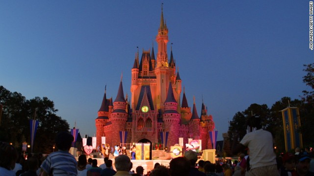 Caption:	 397155 13: People watch a show on stage in front of Cinderella's castle at Walt Disney World's Magic Kingdom November 11, 2001 in Orlando, Florida. (Photo by Joe Raedle/Getty Images)