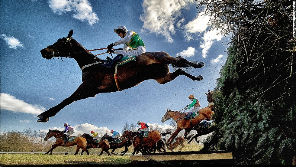 "<strong>Aintree, Liverpool, UK: </strong>Horses and jockeys negotiate the famous Bechers Brook fence during The John Smith's Foxhunters Steeple Chase. Crowhust took four cameras to Aintree in April, this year. ""I had three remote cameras and one in hand which sets off the other three. They're only jumping once, so you've got to make the most of the oportunity,"" he says. ""You get nice shapes in jumping as well when (the horses) stretch."""