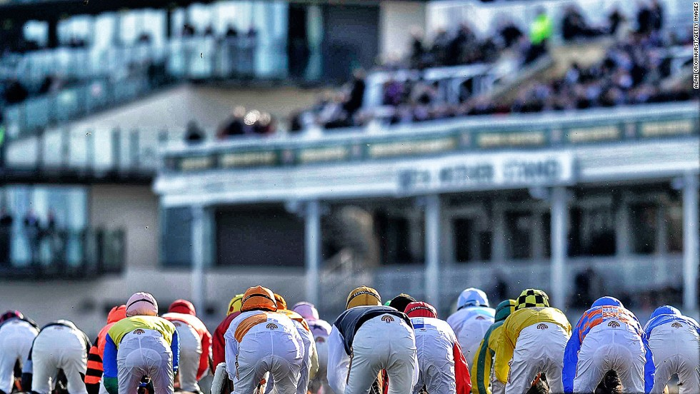 <strong>Aintree, Liverpool, UK: </strong>Runners making their way past the grandstand at Aintree. Crowhurst prefers jump racing because of its unpredictable nature. A horse that is 10 lengths clear can always fall at the last, he says.