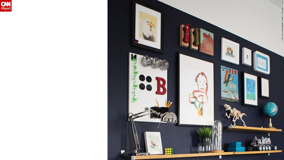 "<a href=""http://ireport.cnn.com/docs/DOC-1035909"">Katja Kromann</a> created this <a href=""http://shiftctrlart.com"" target=""_blank"">gallery wall with floating bookshelves</a> for her son's room. To find out more about the decorative elements she used, ask in the comments section."