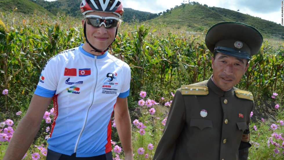 Swedish racer Christian Bertilsson with North Korean police on a countryside road.