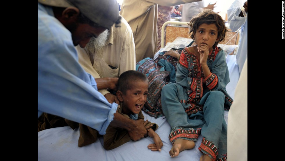 Pakistani children are treated in a makeshift hospital on September 25.
