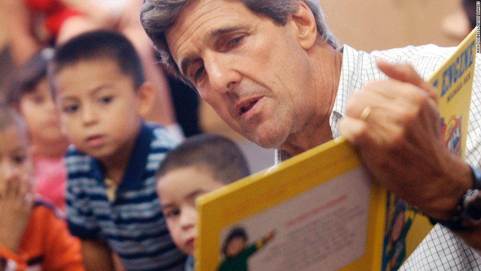 "Sen. John Kerry, D-Massachusetts, reads ""My Fire Engine"" to a group of children from YDI Pedro Baca Head Start Center in Albuquerque, New Mexico, in September 2003."