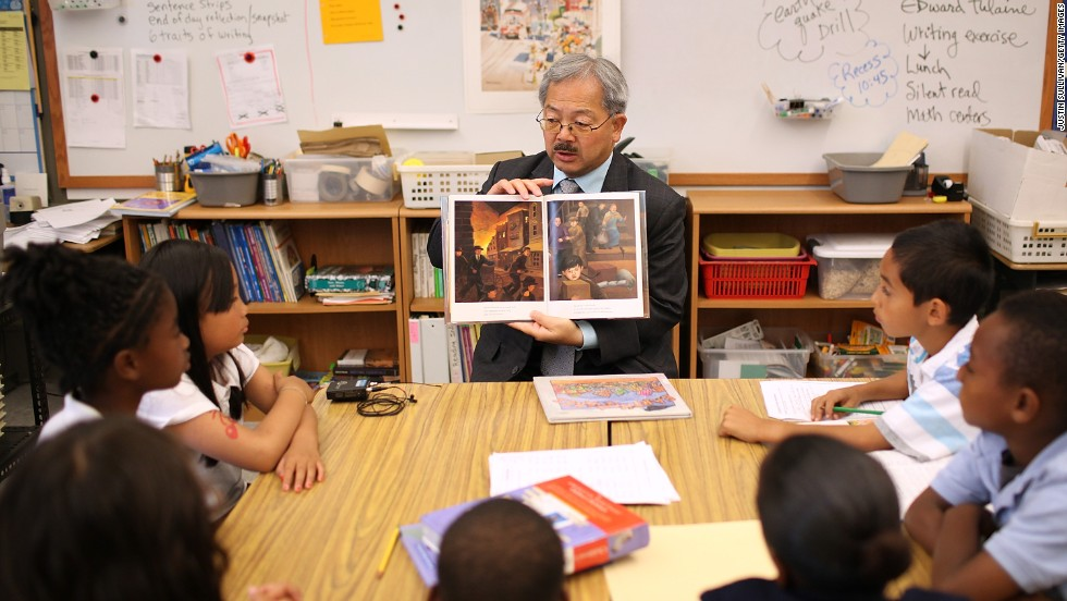 "San Francisco Mayor Ed Lee reads a book about earthquakes to third-grade students at William L. Cobb Elementary School as they participate in the ""Great California ShakeOut"" earthquake drill in October 2011."