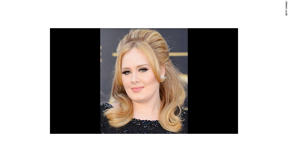 Adele wears jet black winged liner and lush lashes courtesy of makeup artist Michael Ashton.