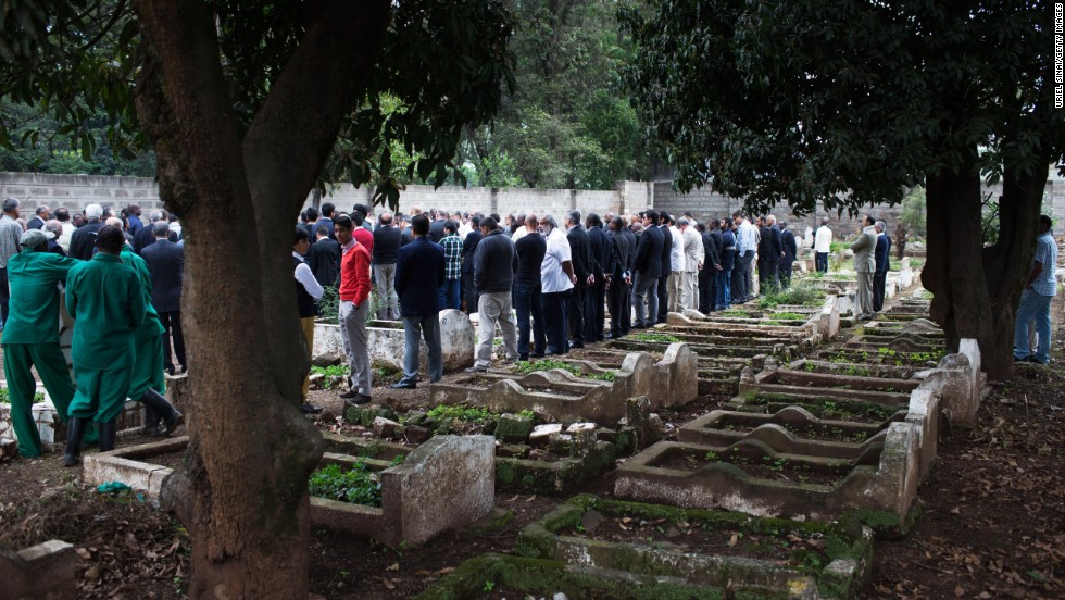 People gather for a funeral on September 25.