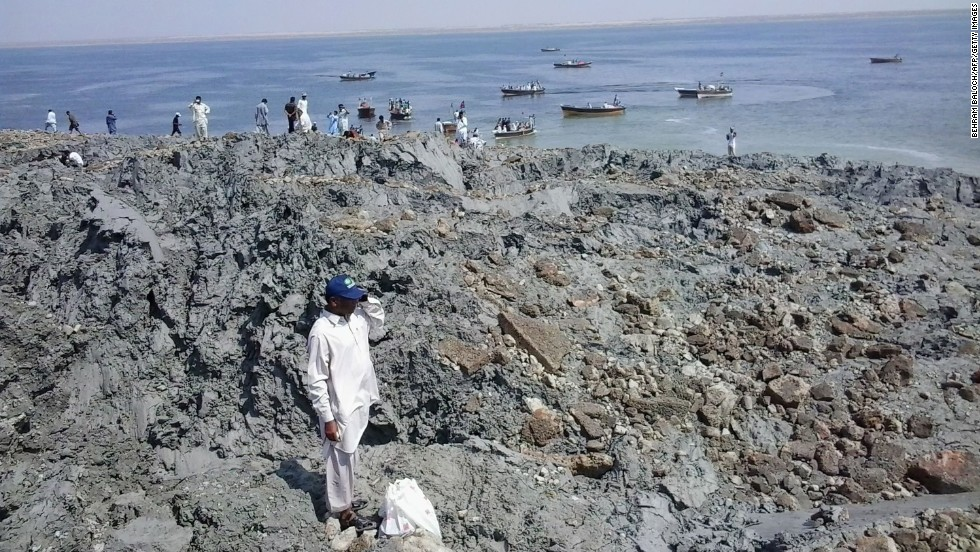 People gather on an island on Wednesday, September 25, that appeared off the coast of Gwadar after the earthquake.