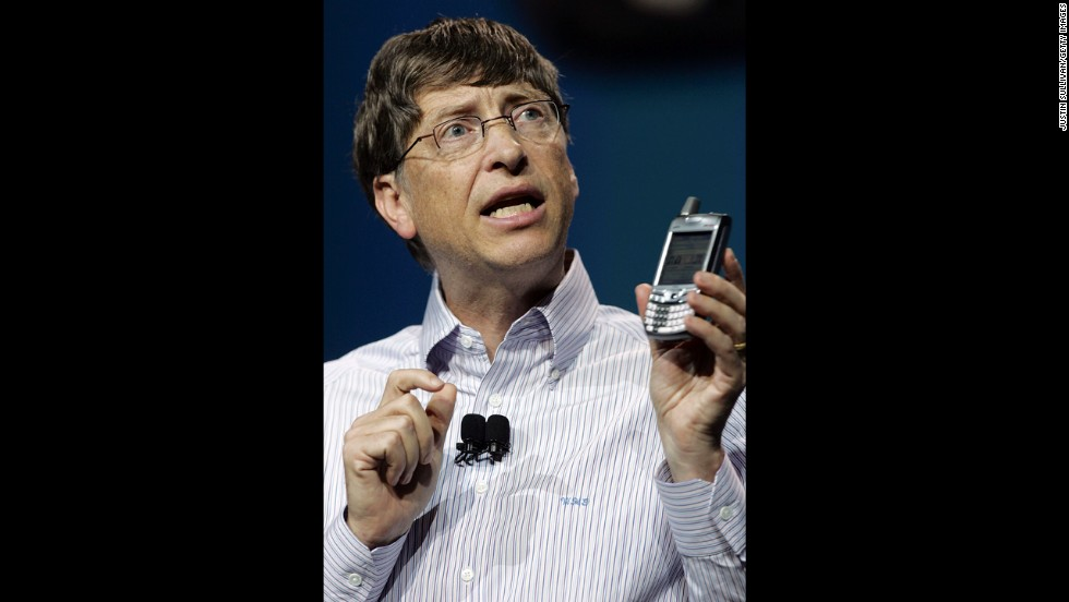 Gates holds a new Palm Treo 700w smartphone during a keynote address at the 2006 Consumer Electronics Show in Las Vegas.