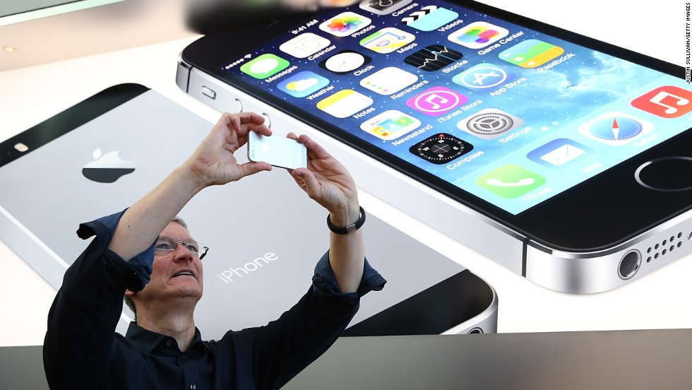 How much of an upgrade is the camera on the new iPhone 5S (as wielded here by Apple CEO Tim Cook)? CNN's Heather Kelly snapped a series of photos with both phones to compare.