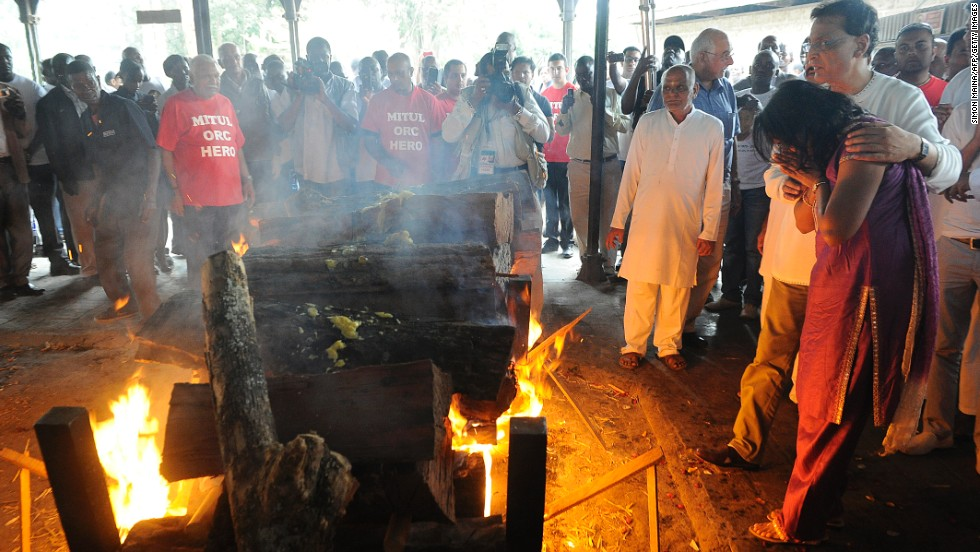 Family members light a funeral pyre at the Sikh funeral of Mitul Shah, the president of a football team in Kenya, in Nairobi on September 26.