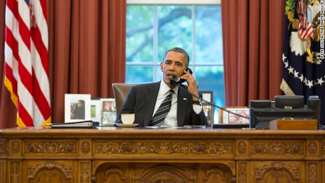 President Barack Obama talks with President Hassan Rouhani of Iran during a phone call in the Oval Office, Sept. 27, 2013. (Official White House Photo by Pete Souza)
