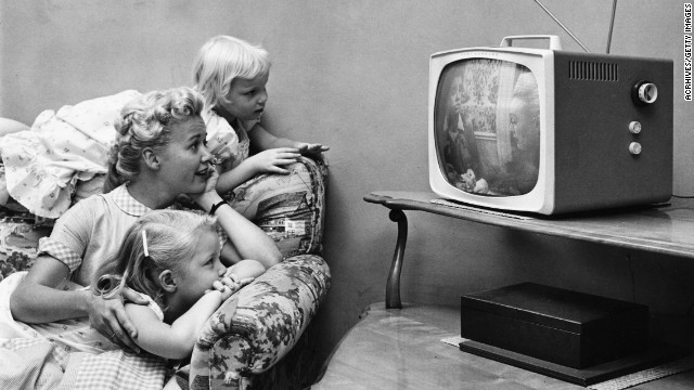black kids watching tv. tv rating system not accurate, little help to parents, study says black kids watching tv i