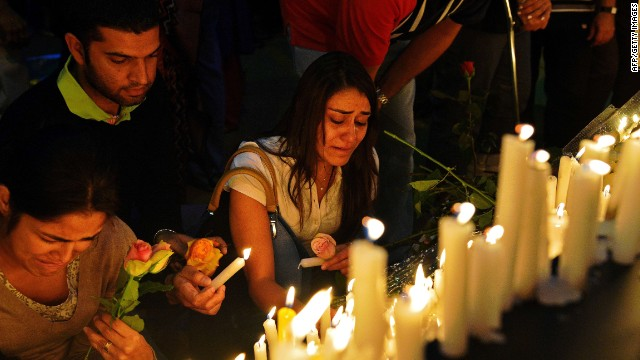A woman cries as she lights a candle during a 24 hour prayer vigil for victims of the Westgate mall massacre near the Westgate Mall on September 28, 2013.