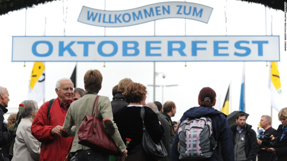 People stand outside of the memorial for the victims of the 1980 Oktoberfest bombing on Thursday, September 26.