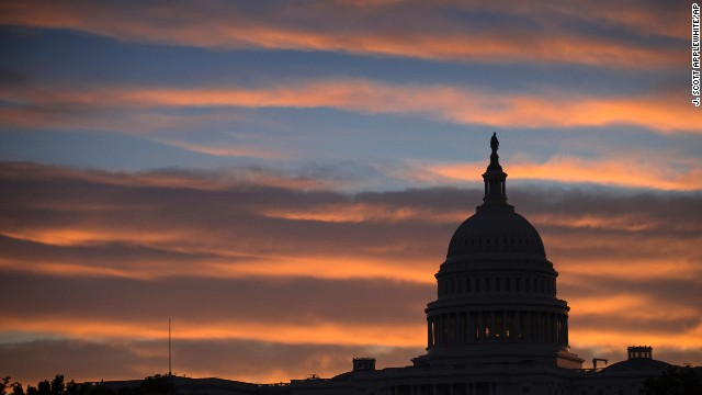 The U.S. Capitol in Washington is seen at dawn on Monday as the country faces a. possible government shutdown at midnight.