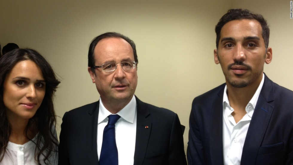 Belounis (right) held talks with French President Francois Hollande in June and claims he had been told he would receive his exit visa on October 21 -- it came more than a month later.