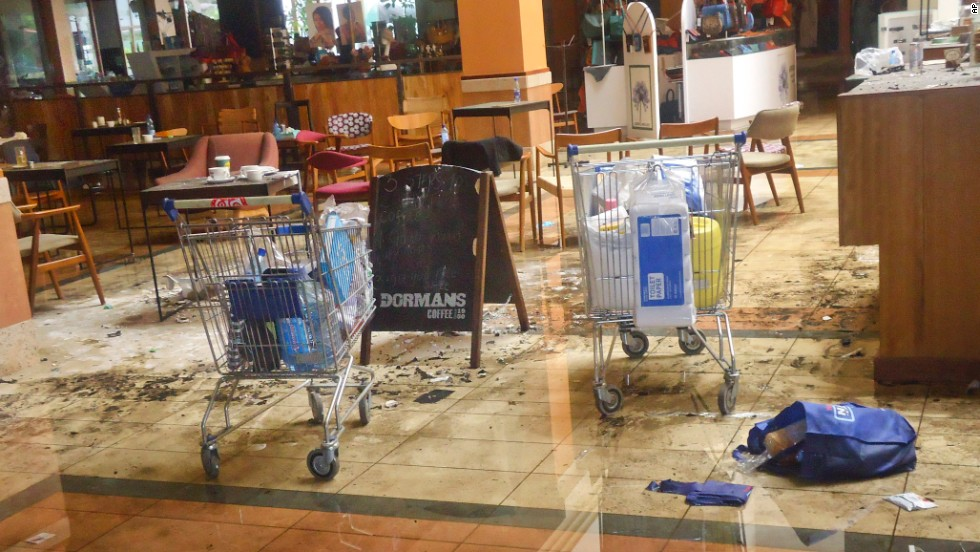 This photo taken Friday, September 27, shows the scene at the Dormans coffee shop on the ground floor of the Westgate Shopping Mall in Nairobi, Kenya, days after an attack and siege left 67 people dead. Click through to see images of the mall after the four-day siege.