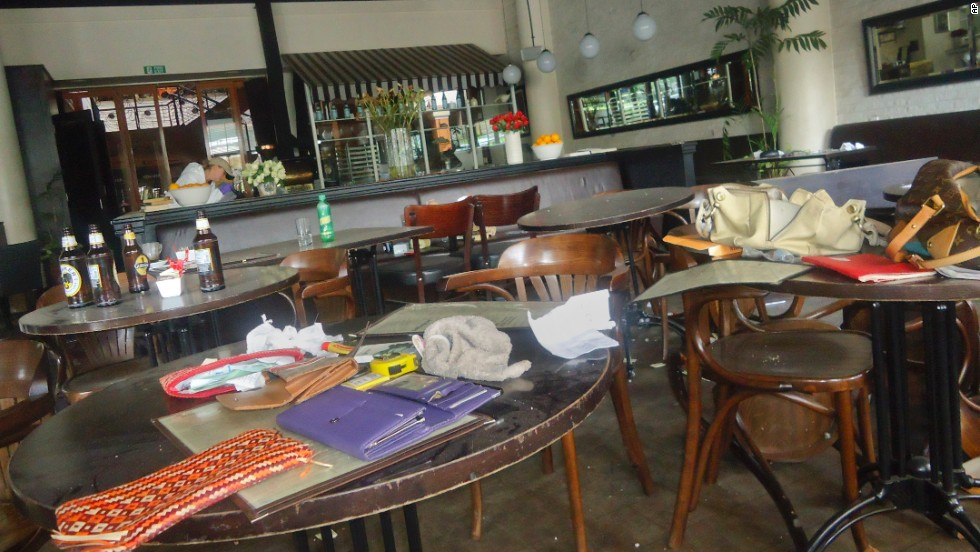 Wallets and purses sit on tables inside the Artcaffe restaurant and coffee shop.