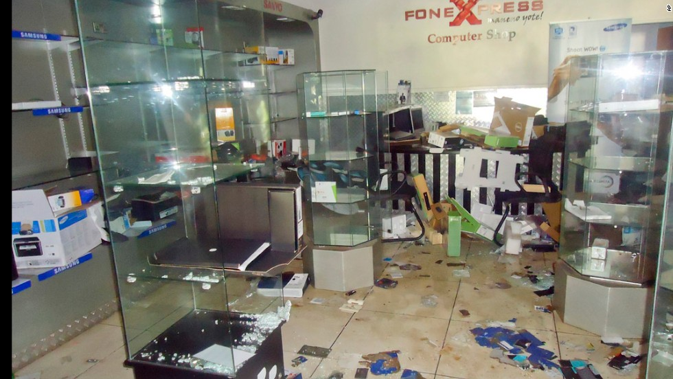 Debris is scattered around the FoneXpress computer shop.