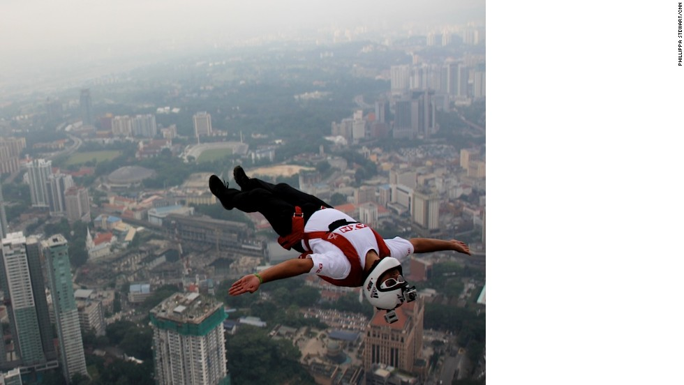 Base Jumpers Leap Off Malaysias Kuala Lumpur Tower CNN Travel - Crazy guy base jumps radio tower