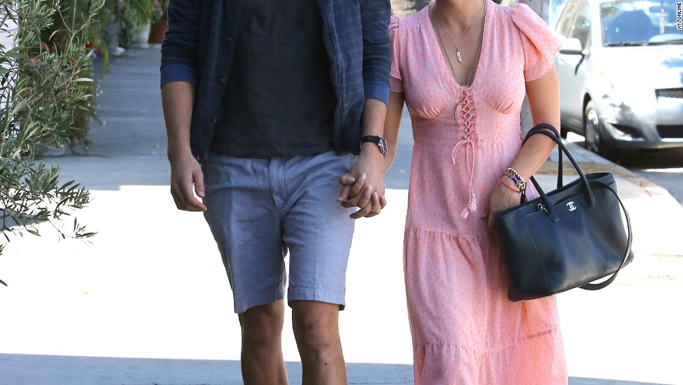 Kaley Cuoco and her new fiance Ryan Sweeting stroll through Los Angeles on September 28.