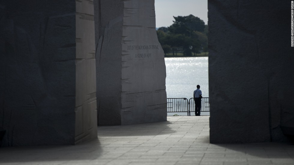 A U.S. Park Service police officer stands at the closed Martin Luther King Jr. Memorial on the National Mall in Washington on October 1.