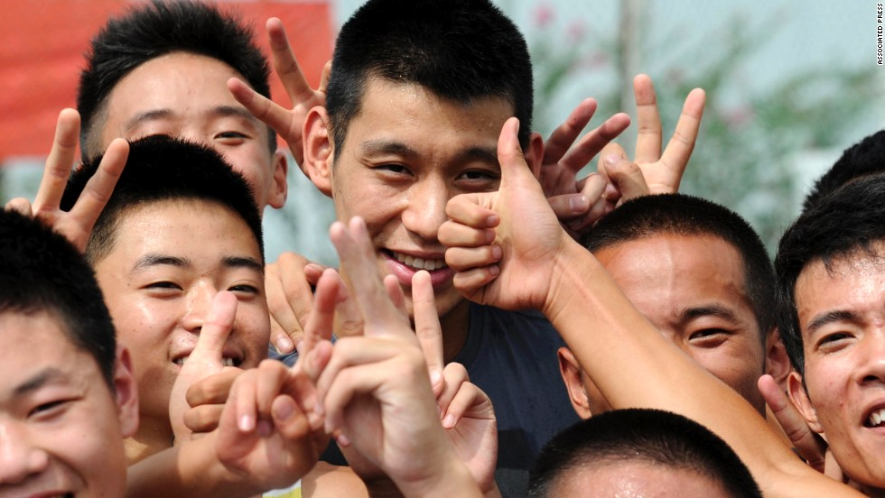 Lin, now a player for the the Houston Rockets, posed for photos with fans while visiting southwestern China on August 30.