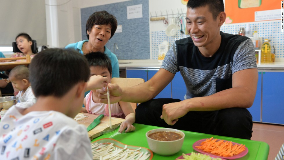 Lin makes noodles with children as he visits the Prince of Peace Children's Home and Children's Rehabilitation Center in Tianjin, China, in August. Lin said he would like to do Christian missionary work or nonprofit work when he's through playing basketball.