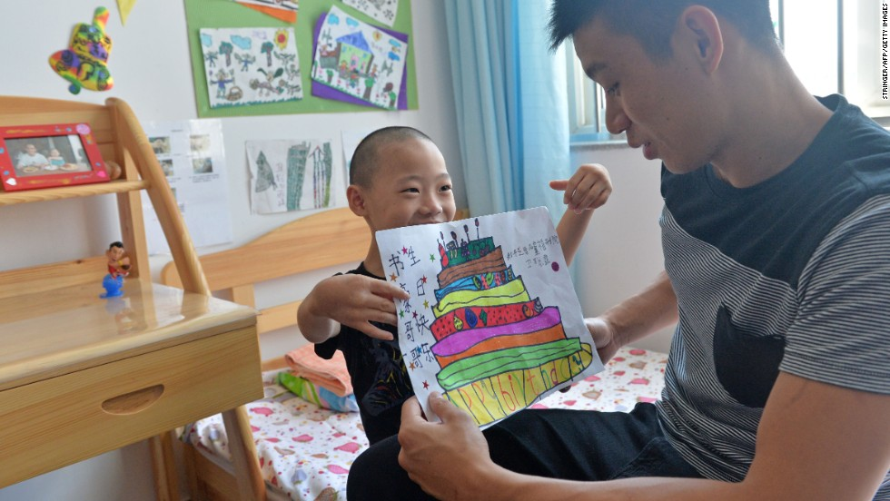 A child at Prince of Peace Children's Home gave Lin a birthday gift; the NBA star, who turned 25 in August, was visiting for a three-day basketball camp in Beijing.