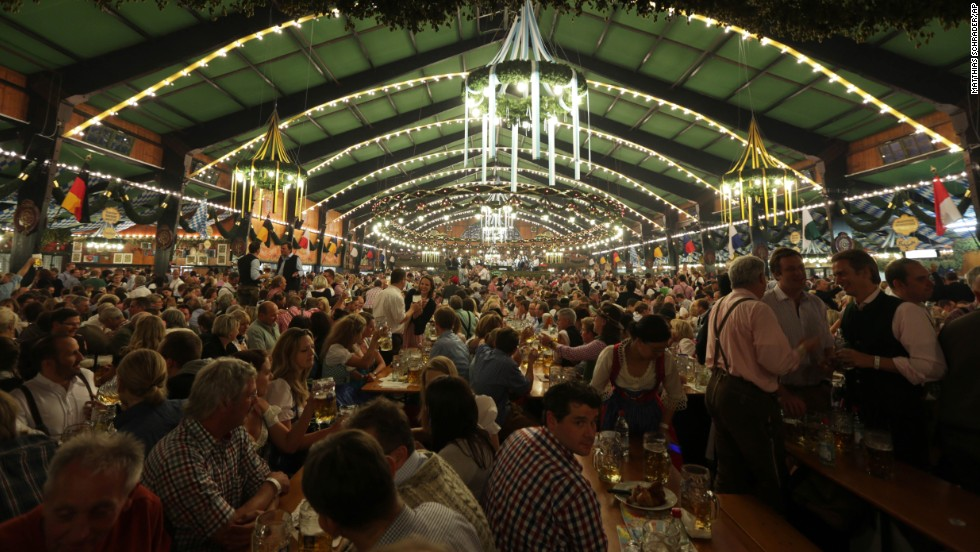 Visitors enjoy the evening at the Oktoberfest 2013 beer festival in Munich on Wednesday, October 2. Oktoberfest is the world's largest beer festival and runs September 21 through October 6.