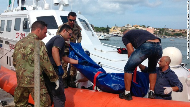 The body of a drowned migrant is unloaded from a Coast Guard boat in Lampedusa in October 2013.