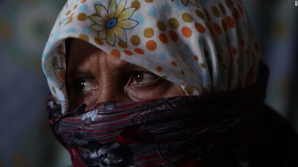 The girl's grandmother (pictured) says she fled her hometown in northern Syria after a bomb destroyed her home, killing two of her teenage children.