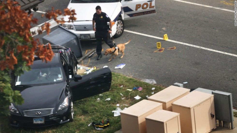 A police officer and K9 inspect the scene after a car chase and reports of gunshots fired outside of the Hart Senate Office Building on Captiol Hill on Thursday, October 3 in Washington. Police said the U.S. Capitol was put on security lockdown.
