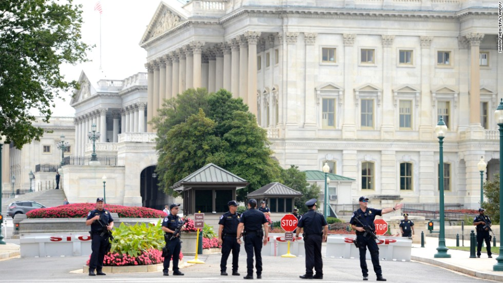 Police stand guard at the Capitol.