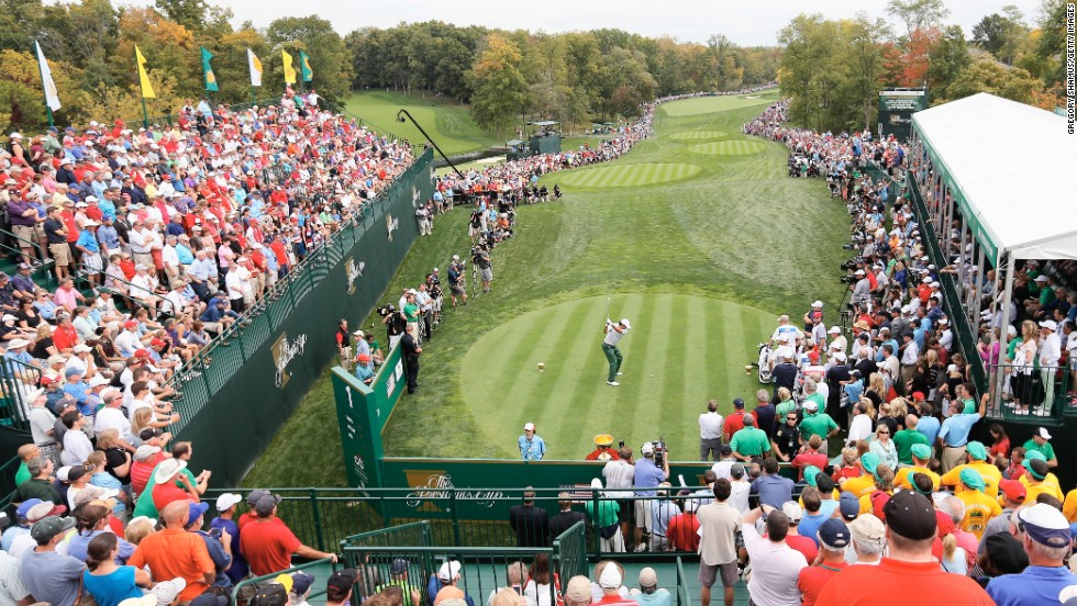 The Presidents Cup isn't as prestigious as the Ryder Cup but the fans still showed up in droves. Here they watched as Australia's Jason Day struck his tee shot.