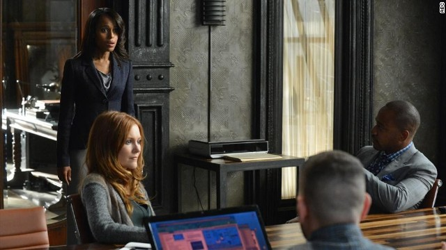 "Kerry Washington, in blue, stars as professional ""fixer"" Olivia Pope on ABC's ""Scandal."""