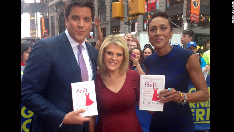 "Johnson is the ""Deals and Steals"" contributor to ABC's ""Good Morning America."" She poses here in New York's Times Square after her book launch with Josh Elliott and Robin Roberts."