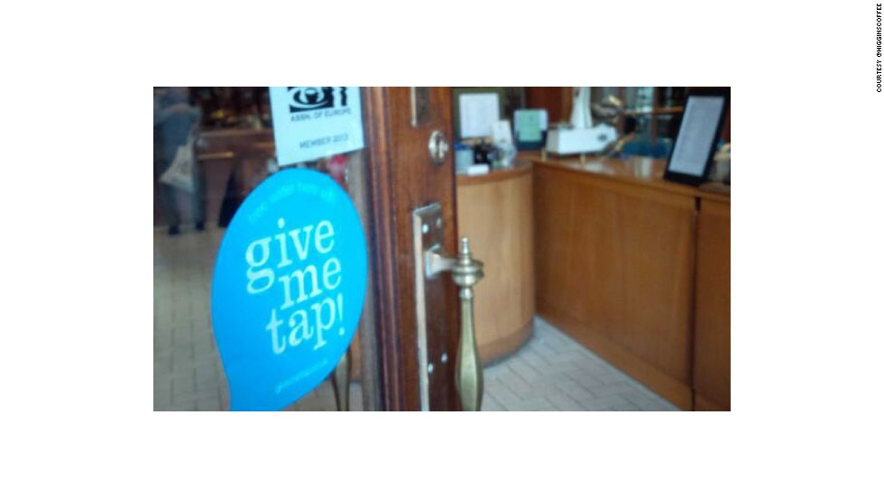 "Cafes and restaurants participating in the free water refill scheme can let customers know by sticking GiveMeTap stickers on windows and doors, like <a href=""https://twitter.com/Higginscoffee"" target=""_blank"">H.R. Higgins Coffee </a>in London. GiveMeTap has also developed an iPhone app that helps you find your nearest refill point in the UK."