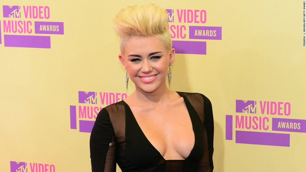 Cyrus poses on the red carpet for the MTV Video Music Awards in Los Angeles in September 2012.