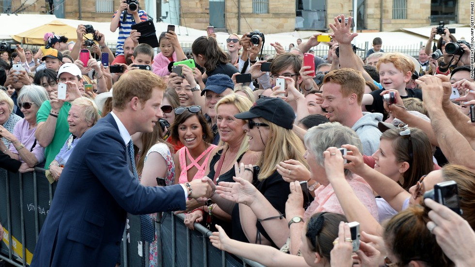 Britain's Prince Harry meets members of the public during a walk-around at Campbell's Cove in Sydney on October 5.