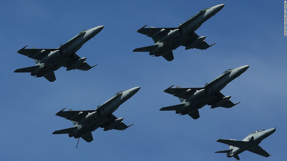 A formation of F/A-18 Hornets and Hawks fly over Sydney Harbor on October 5.