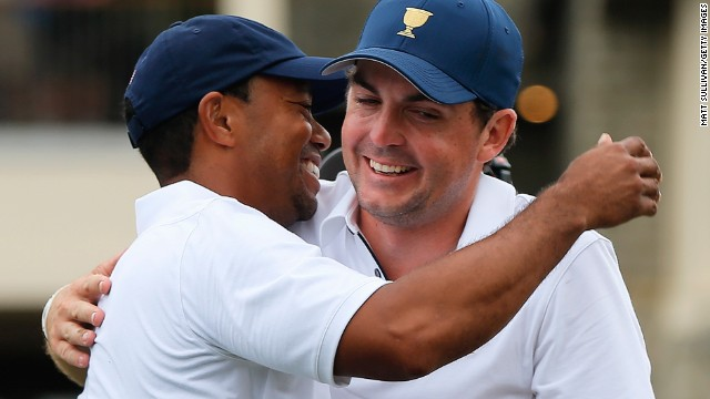 Keegan Bradley, right, congratulates Tiger Woods after his U.S. teammate secures victory in the Presidents Cup in Ohio.