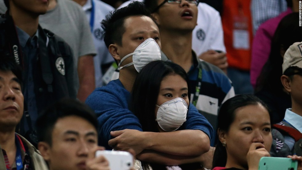 Masks were seen in the crowd Sunday also. This couple were spotted watching Novak Djokovic down Rafael Nadal in the men's final.