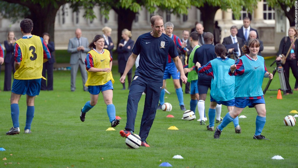 Prince William shows off his footballing skills during a training session on the grounds of Buckingham Palace.