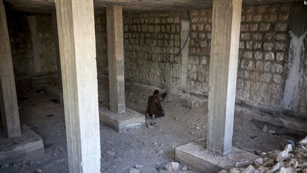 A rebel fighter prays moments before heading into battle in Maaret al-Numan, Syria, on Monday, October 7.