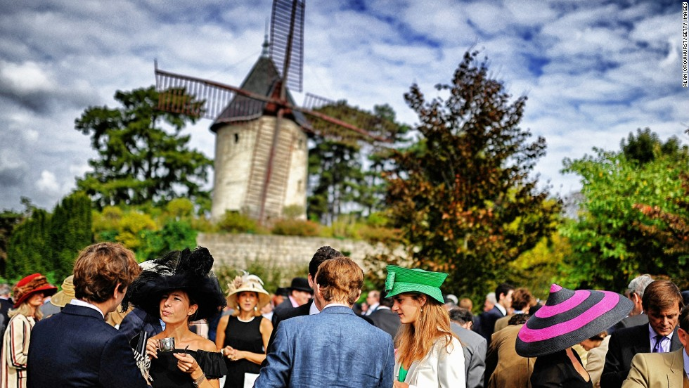As Crowhurst's images reveal, a race meeting is as much about the drama off the track as it is on it. The photographer was at Longchamp in Paris for the Prix de l'Arc de Triomphe -- European racing's richest prize -- on Sunday to capture the windmills and hats as well as the racing.