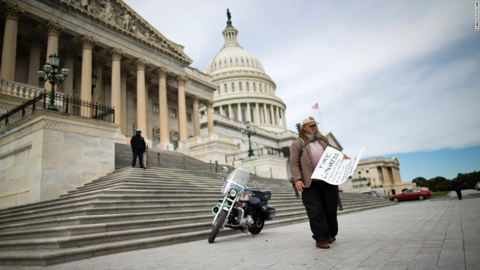 "Rick Hohensee holds a ""Fire Congress"" sign near the House steps on Capitol Hill in Washington on Tuesday, October 8."