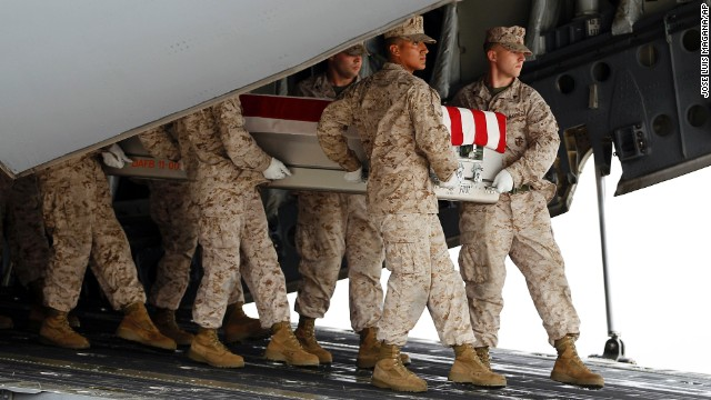 A Marine carry team, carries the transfer case containing the remains of Marine Lance Cpl. Jeremiah M. Collins Jr. of Milwaukee, Wis., upon arrival at Dover Air Force Base, Del. on Monday, Oct. 7,  2013. The Department of Defense announced the death of Collins Jr. who was supporting Operation Enduring Freedom in Afghanistan. ( AP Photo/Jose Luis Magana)