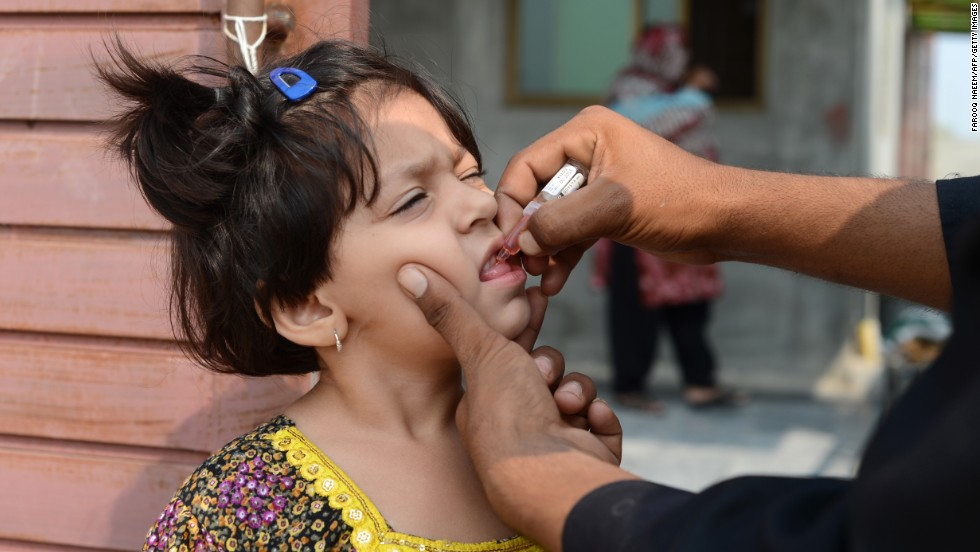 A Pakistani child receives an oral polio vaccine during an anti-polio campaign in Rawalpindi on October 1, 2013. The Polio virus saw a huge surge in year 2011, with as many as 198 cases reported from different parts of the country, forcing the government to enhance the immunization in affected regions.