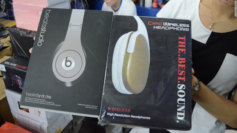 In an attempt to trick customs officials, counterfeiters send fake Beats in two boxes; the outer box, on the right,  has a made-up name to hide the real goods.